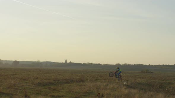 Thumbnail for Riding a motocross on a field