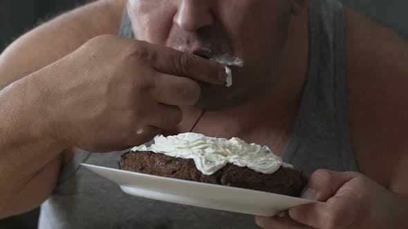 Thumbnail for Fat Man Swallowing Up Chocolate Cake, Unhealthy Food, Diet Get Out Of Control