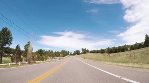 POV-Driving on rural paved road in Colorado.