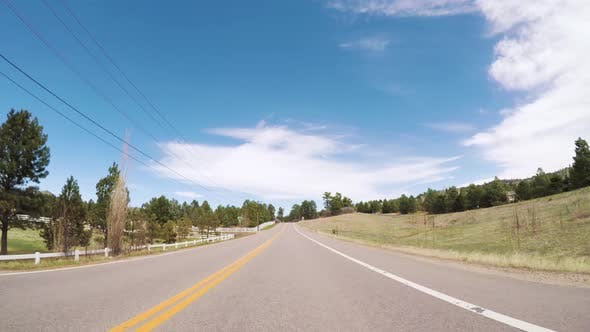 Thumbnail for POV-Driving on rural paved road in Colorado.