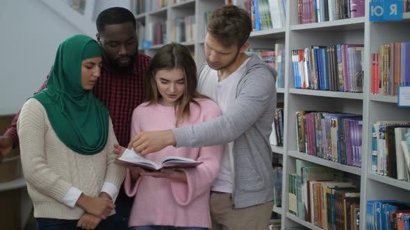 Cover Image for Diverse Students Standing Near Bookshelves