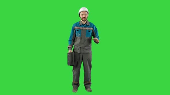 Thumbnail for Builder in Helmet with a Suitcase Says on Camera on a Green Screen, Chroma Key
