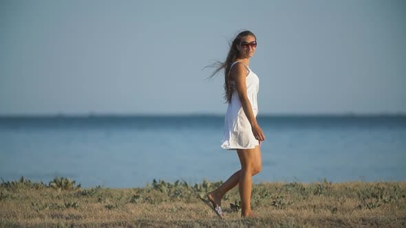 Thumbnail for Girl in a White Dress Near the Sea