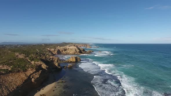 Thumbnail for Spectacular Scenery View of Rocky Ocean Coastline with Foaming Waves, Camera Rises Up, Far Horizon