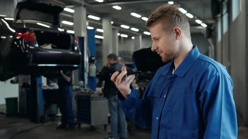 Man Voice Recognition with Smart Phone in Car Mechanic Workshop Service Factory Message Audio Welder