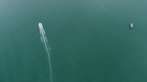 Aerial view of speed boats on the sea near beach city