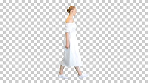 Young woman in white dress walking, Alpha Channel
