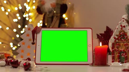 iPad Air tablet with pre-keyed green screen, Christmas background, Easy to paste your content