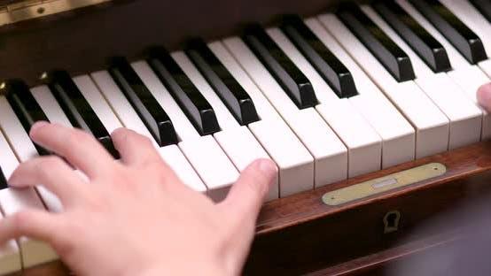 Thumbnail for Man playing piano