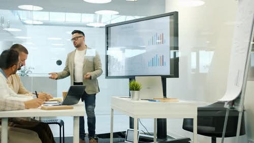 Business Expert Speaking About Marketing in Office Using Digital Whiteboard