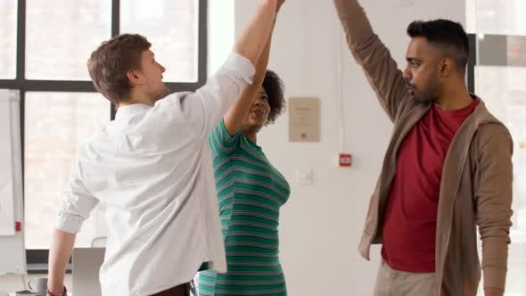 Thumbnail for Happy Creative Team Making High Five at Office 53