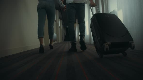 Thumbnail for Couple Legs Walking Hotel Corridor. Unknown Couple Traveling Together.