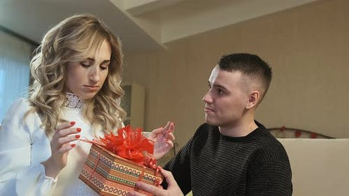 A Young Guy Gives His Girlfriend a Present