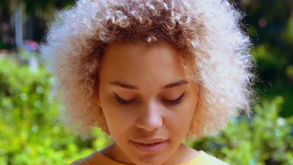 Thumbnail for Outdoor Portrait Blonde Teenager with Curly Hair