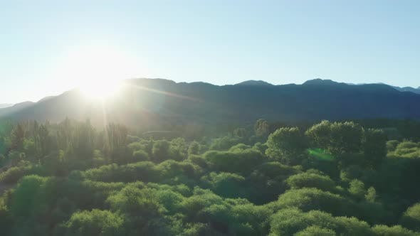 Thumbnail for Drone Over Glowing Sunlight And Mountains