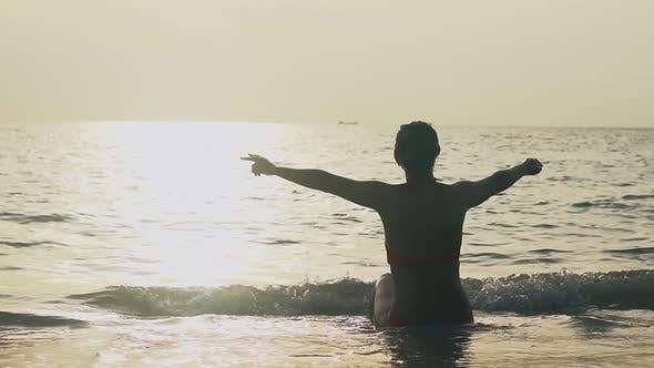 Girl Silhouette Shows Victory Gesture at Ocean Slow Motion