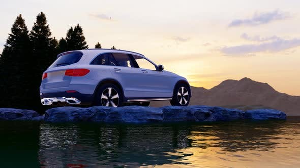Thumbnail for White Luxury Off-Road Vehicle Standing on Rocks with Sunset View