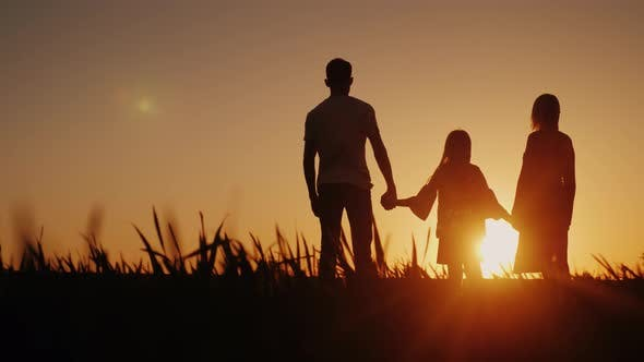 Thumbnail for A Happy Family of Three People Meets the Dawn in a Picturesque Place