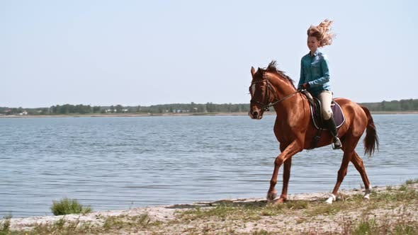 Thumbnail for Happy Young Woman Riding Thoroughbred Horse