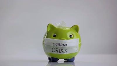 Piggy Bank with Inscription Corona Crisis