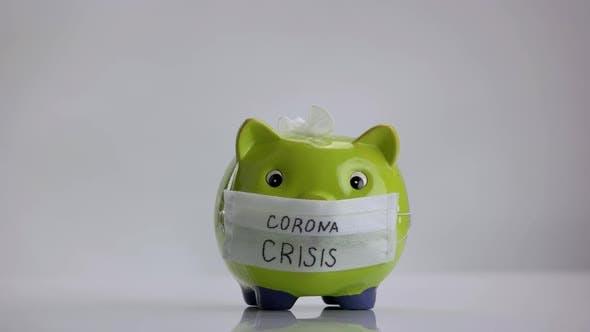 Sparschwein mit Inschrift Corona-Krise
