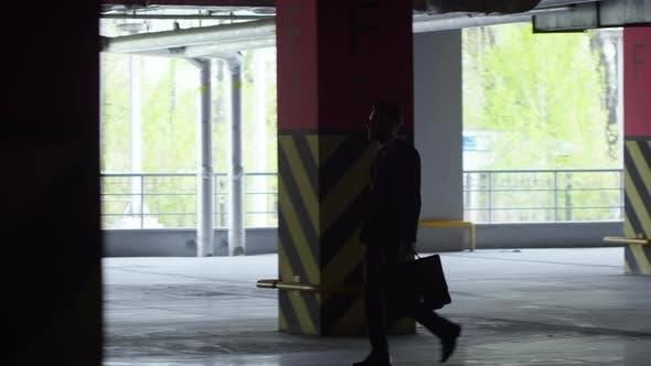 Thumbnail for Businessman Walking through Underground Garage