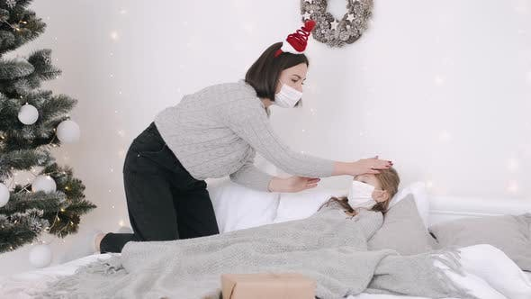 Thumbnail for Mother and Ill Child in Bed During New Year Holidays