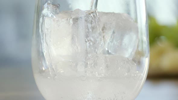 Thumbnail for Pouring Mineral Water Over Ice Cubes