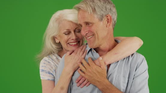 Thumbnail for Happy elderly couple standing out by the beach hugging on green screen