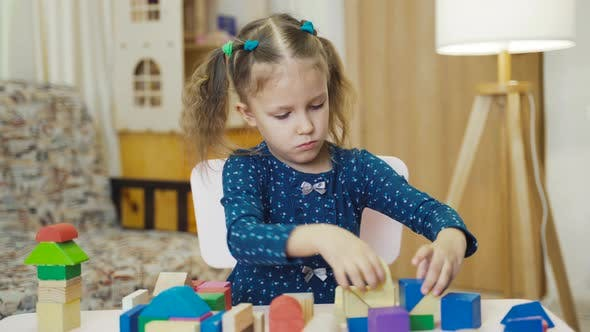 Thumbnail for Little Girl Child Playing Toys Cubes At Home
