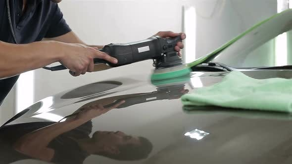 Thumbnail for Close Up Shot Man Waxing Hood Car Special Tool