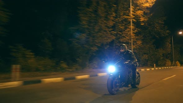 Thumbnail for Motorcyclist Racing His Motorcycle on Night Road. Young Man Riding Fast on Modern Sport Motorbike at