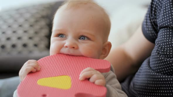 Thumbnail for Baby Boy Chewing His Colourful Toy