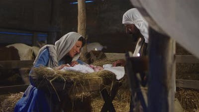 Mary And Joseph with Baby Jesus in Barn