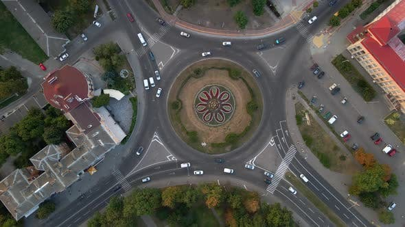 Thumbnail for Aerial View of Roundabout Road with Circular Cars in Small European City at Summer Day