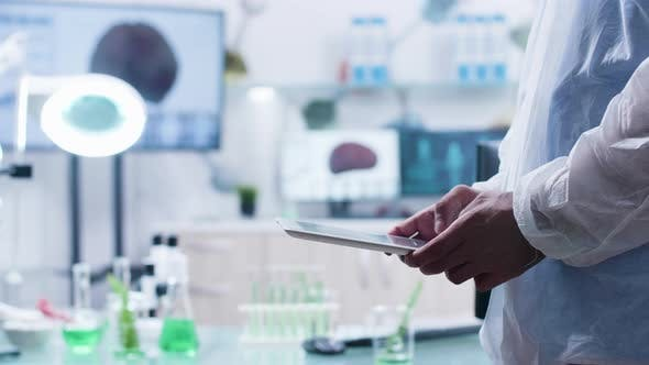 Thumbnail for Wide Shot of Researcher Using a Digital Tablet Pad