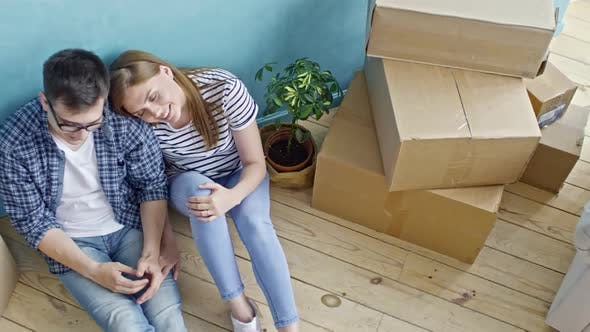 Thumbnail for Loving Couple Sitting on Floor of New Flat