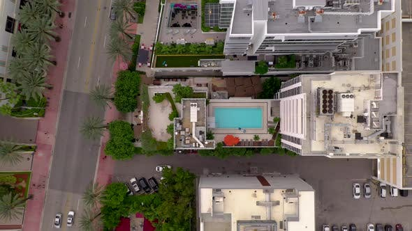 Thumbnail for Aerial Rising Above Hotel Swimming Pool 4k