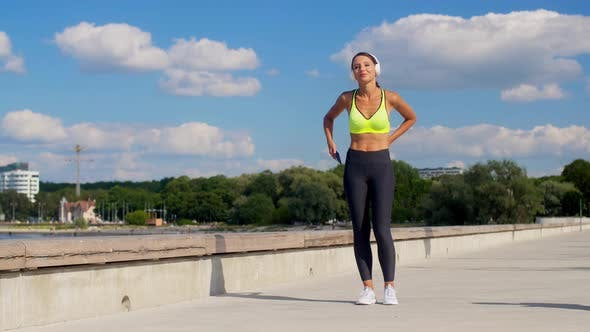 Thumbnail for Woman with Headphones and Smartphone Running