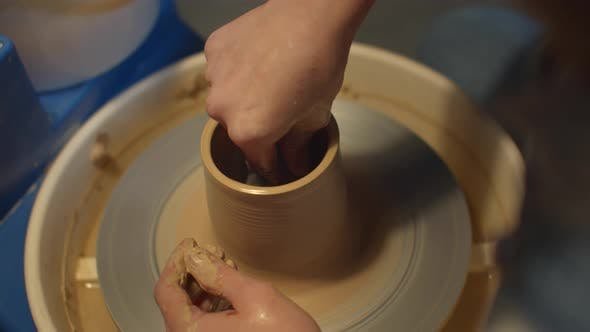 Pottery Craftsmanship. Girl Makes a Handmade Vase