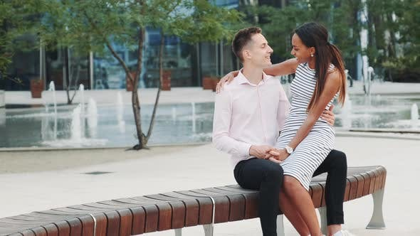 Cover Image for Cheerful Multiracial Couple Having Date Outdoors Near the Fountains