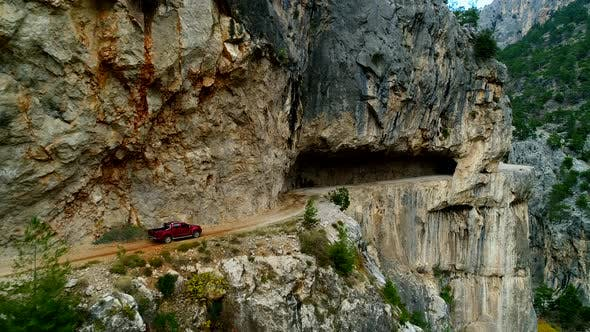 Thumbnail for Car Driving Stone Road