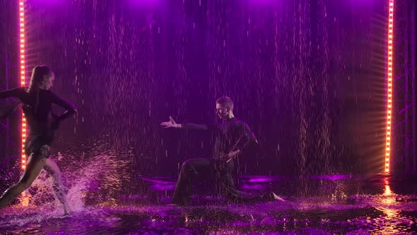 Thumbnail for Jive Elements Performed By a Passionate Couple in the Rain. Photographed in a Dark Studio Against a