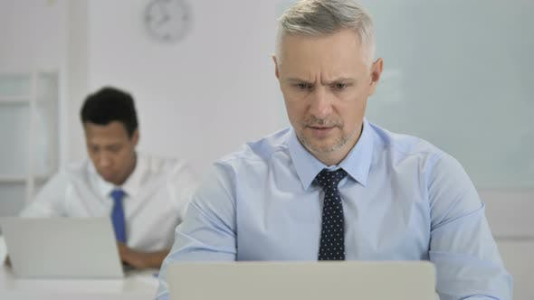 Thumbnail for Grey Hair Businessman Upset By Failure at Work