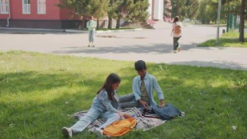 Middle Schoolers Relaxing in Schoolyard