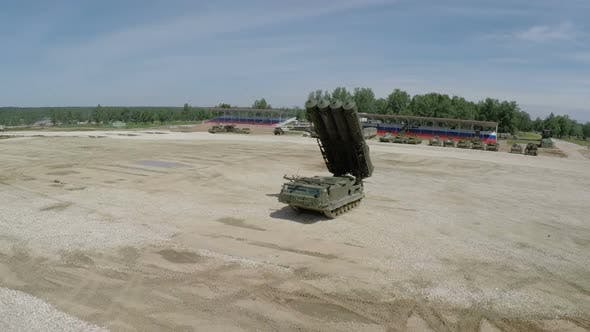 Flying over missile launcher and tanks on shooting-ground