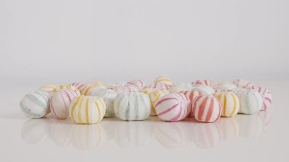 Striped sugar candies close-up 4K tilting video