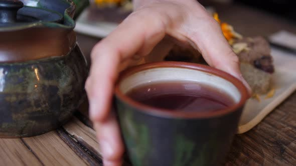 Thumbnail for Tea Ceremony. Pouring Black Tea From Tea Kettle To the Mug.
