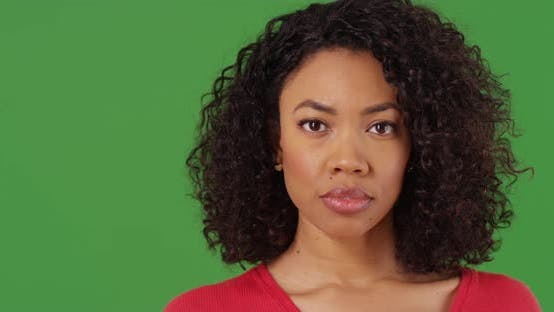 Thumbnail for Close up portrait of serious black woman looking at camera on greenscreen