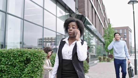 Thumbnail for African Business Lady Walking and Talking on Phone